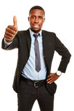 African business man holding thumbs up Stock Images
