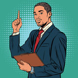 African business man, indicating an important topic Stock Photo
