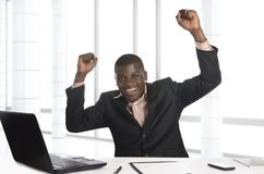 African business man jubilating in office Royalty Free Stock Image