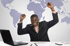 African business man jubilating in office Royalty Free Stock Photo