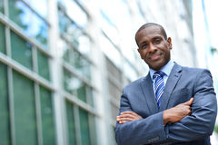 African business man keeping arms crossed Stock Photo