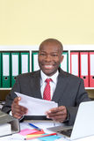 African business man with letter looking at camera Stock Photography