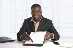 African business man showing contract, free copy space Stock Photos