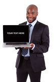 African business man showing a laptop screen Stock Image