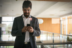 African business man standing in business building. Stock Image