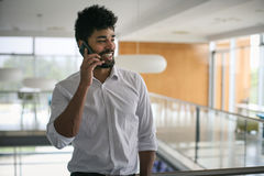 African business man standing in business building. Stock Photos