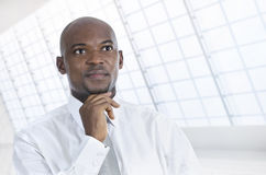 African business man thinking in office Royalty Free Stock Images