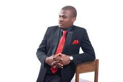 African business man wearing suite posing at studio. Stock Photo