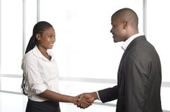 African business partners shake hands Royalty Free Stock Photos