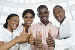 For african business partners / students thumb up Stock Photography