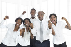 African business team cheering. Studio Shot Stock Image
