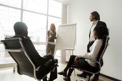 African business team listening to speakers giving presentation stock image