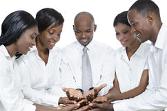 African business team presenting with open hands Stock Images