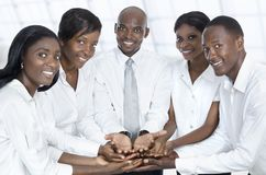 African business team presenting with open hands. Studio Shot Royalty Free Stock Photos