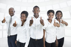 African business team / students thumbs up. Studio Shot Stock Photography