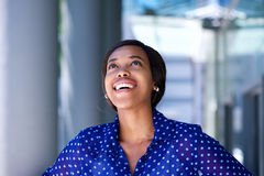 African business woman laughing and looking up Stock Image