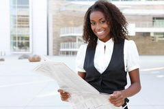 African Business Woman with Newspaper Royalty Free Stock Images