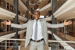 African businessman arms outstretched Stock Photo