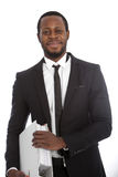 African businessman with a binder under his arm Royalty Free Stock Photo
