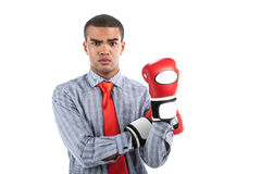 African businessman in boxing gloves over white background. Stock Photography