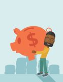 African businessman carries a big piggy bank for Stock Image