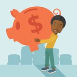 African businessman carries a big piggy bank for Royalty Free Stock Image