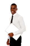 African businessman carrying laptop Stock Photos