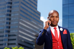 African businessman in the city talking on mobile phone Stock Images