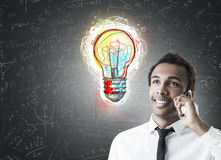 African businessman and colorful light bulb Royalty Free Stock Image