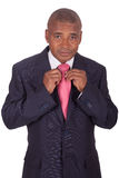 African businessman correcting a tie Stock Photos