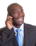 African businessman in a dark suit at phone Royalty Free Stock Photography