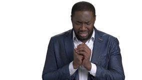 African businessman in desperate praying to god. Crying black businessman with clasped hands near chest. Deep depression and stress because of death of family stock video