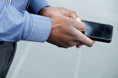 African businessman handsusing mobile phone Royalty Free Stock Photo