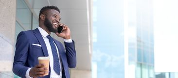 African businessman happily securing a deal with his client during his lunch period. Copy space royalty free stock photo