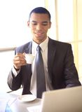 African businessman having coffee break Stock Photos