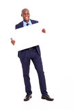 African businessman holding banner Stock Image