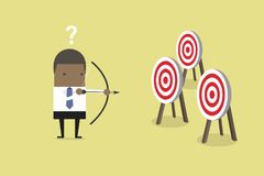 African businessman holding bow and arrow confused by multiple bulls eye target. Vector royalty free illustration