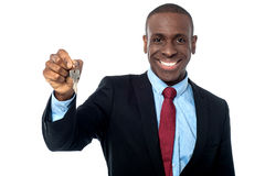 African businessman holding a key Royalty Free Stock Images