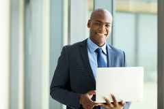African businessman holding laptop Stock Photography