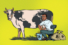 African businessman mines bitcoins milking a cow, world business Stock Image