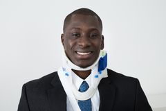 African Businessman With Neck Brace. Portrait Of Happy African Businessman With Neck Brace Stock Photography