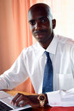 African businessman in office. An african businessman working in office Royalty Free Stock Photo
