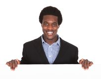 African businessman with placard Stock Image