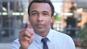African Businessman Pointing with Finger Outdoor. 4k high quality, 4k high quality stock video footage