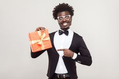 African businessman pointing fingers at gift box. royalty free stock photo
