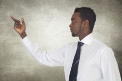 African businessman pointing something Royalty Free Stock Images