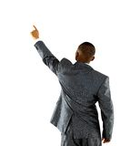 African businessman pointing at wall Royalty Free Stock Images