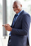 African businessman reading email. Happy african american businessman reading email on smart phone Royalty Free Stock Image