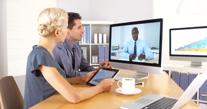 African businessman remotely having a discussion with colleagues Stock Photo