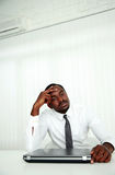 African businessman sitting at his workplace. In office Stock Images